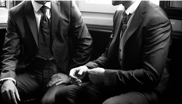 businessmen white black suits 768x439 - ۵ مدل کت و شلوار کلاسیک مردانه برای آقا دامادها